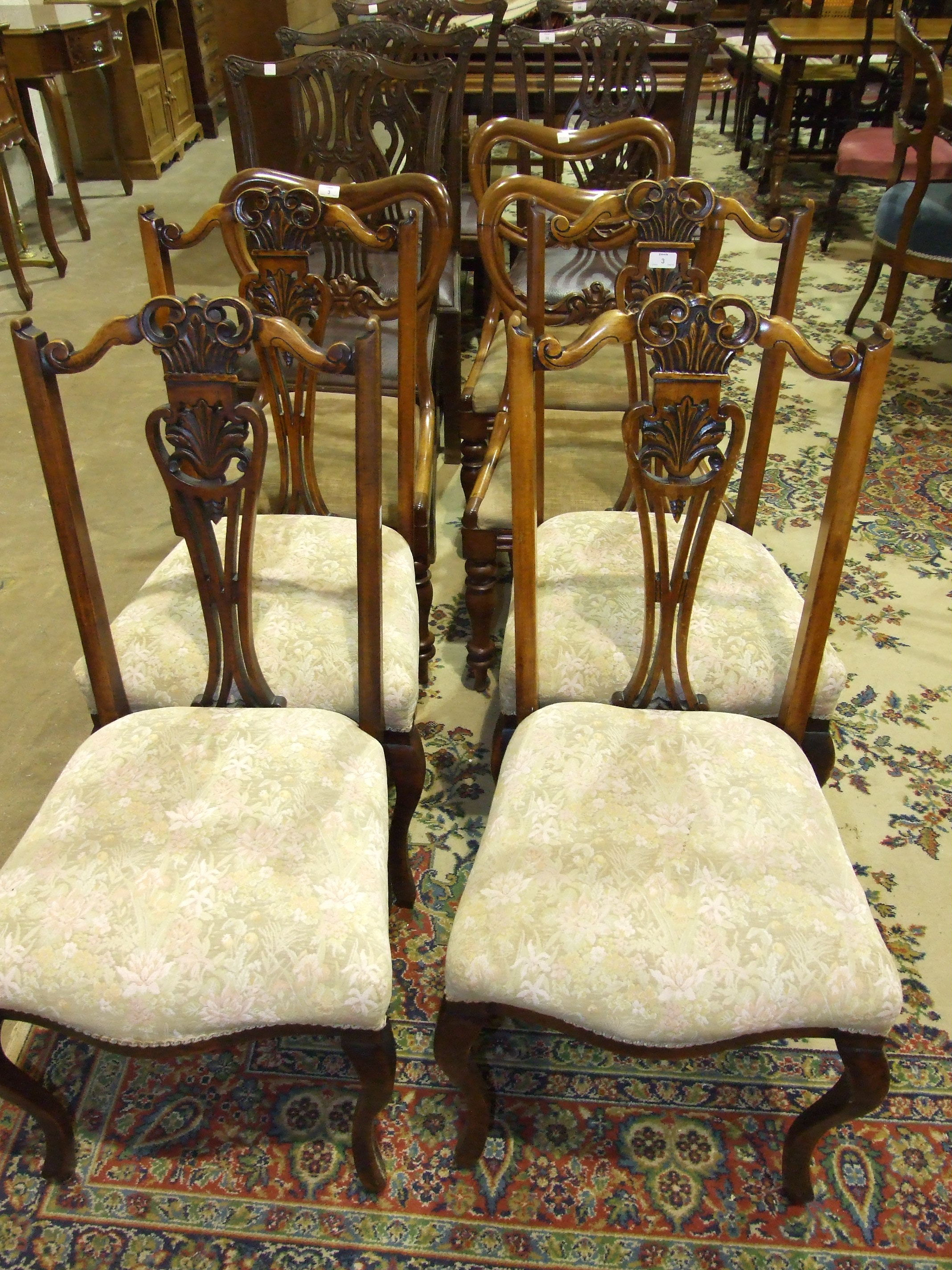 Lot 3 - Three Victorian walnut dining chairs, each with shaped back, carved centre bar, drop-in seats, on
