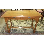 A modern stained pine hall table, the rectangular top above two frieze drawers, on turned legs