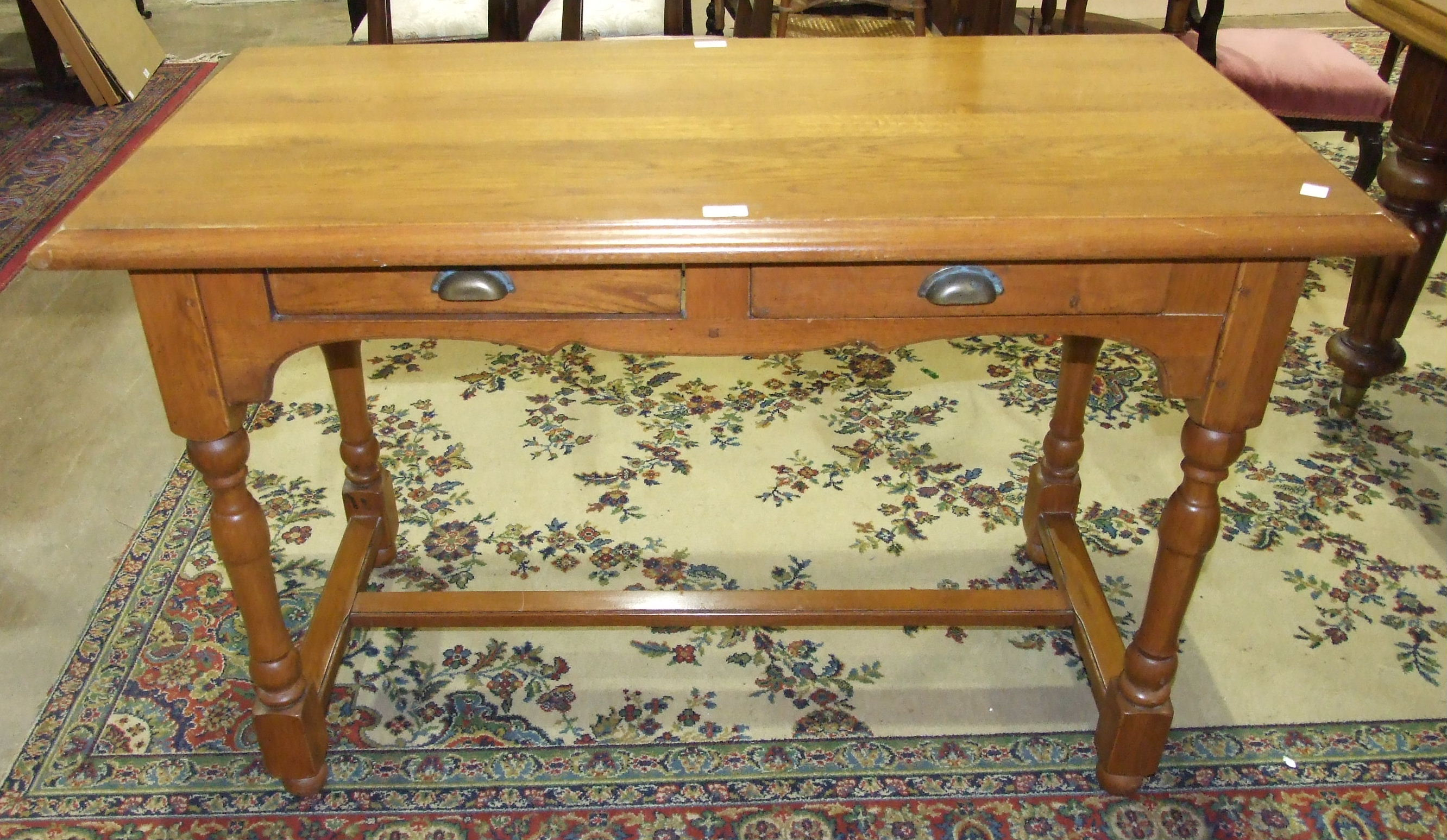 Lot 8 - A modern stained pine hall table, the rectangular top above two frieze drawers, on turned legs