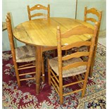 A pine circular table on square tapered splayed legs, 119.5cm diameter and a set of four pine
