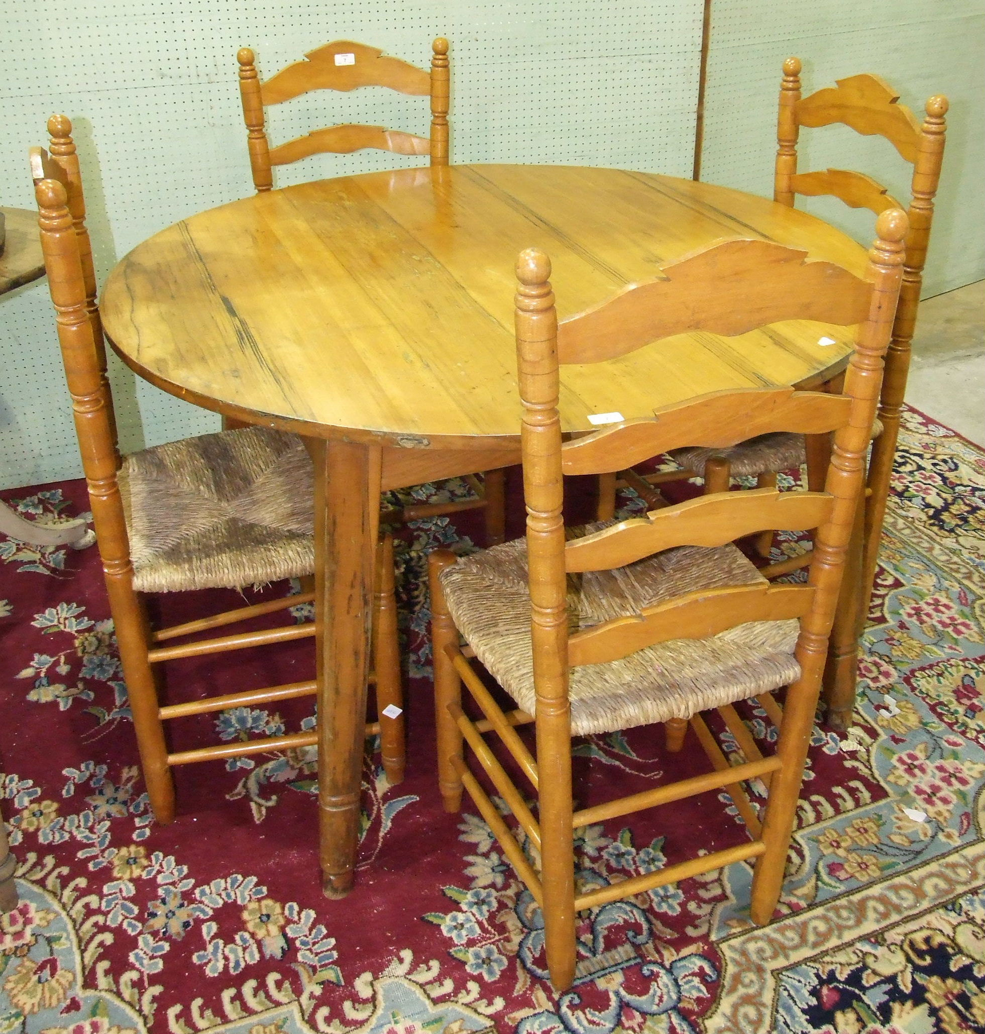 Lot 7 - A pine circular table on square tapered splayed legs, 119.5cm diameter and a set of four pine