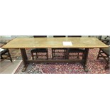 An oak refectory-style narrow dining table, the rectangular top on tapered end supports united by