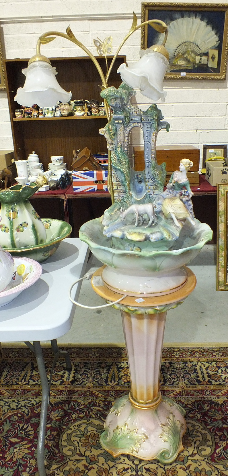 Lot 95 - A ceramic jardinière with attached gilt metal two-light fitting with glass lamp shades and a