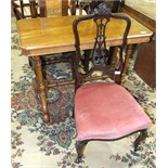 A Victorian walnut hall table, (in need of restoration) and an Edwardian stained wood nursing chair.