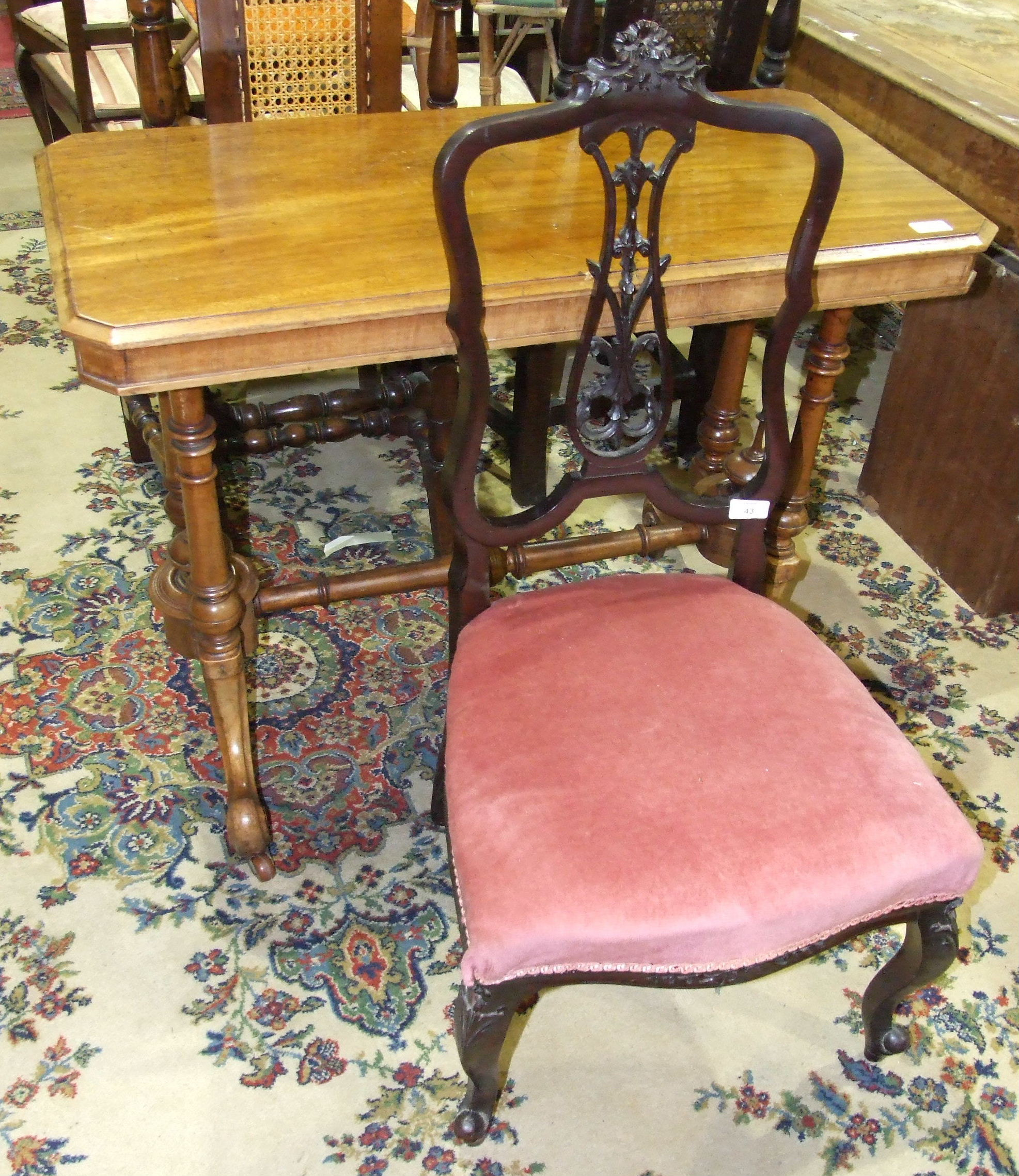 Lot 43 - A Victorian walnut hall table, (in need of restoration) and an Edwardian stained wood nursing chair.