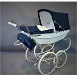 A Silver Cross Heritage toy pram with navy hood, bearing maker's mark and label, H.97 W.46 D.97cm