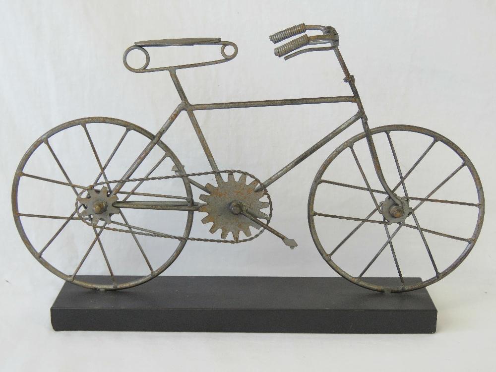 A contemporary metal desk ornament in th