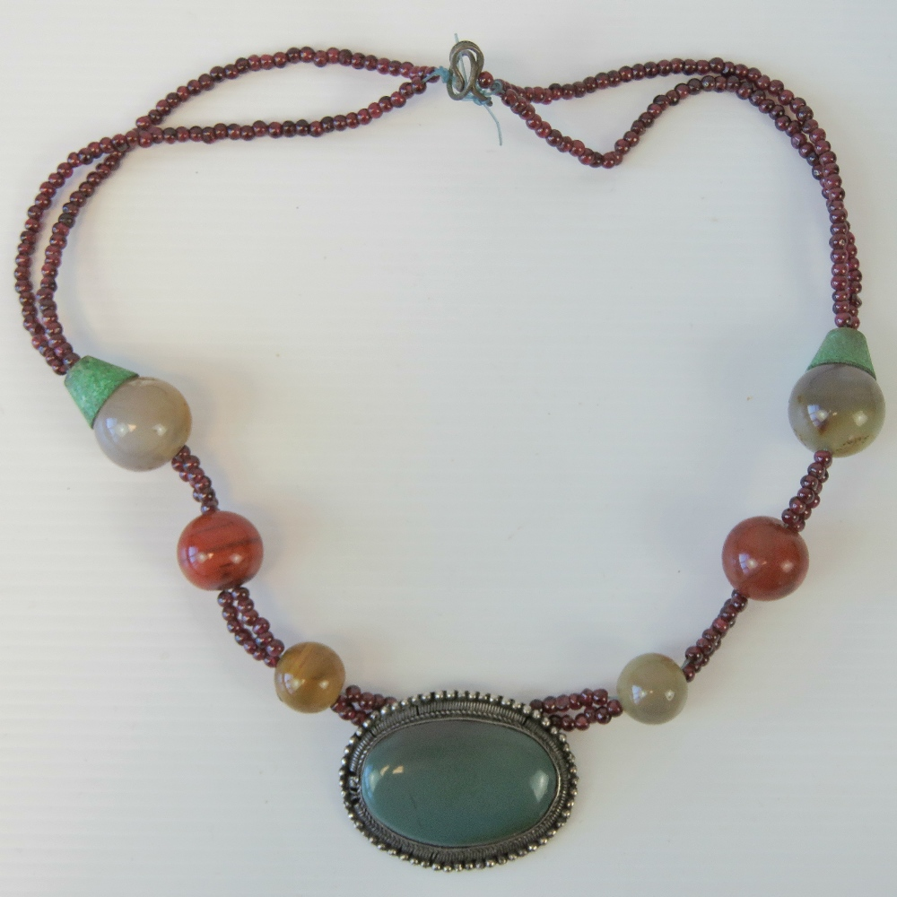 Lot 106 - A handmade hardstone necklace, central w