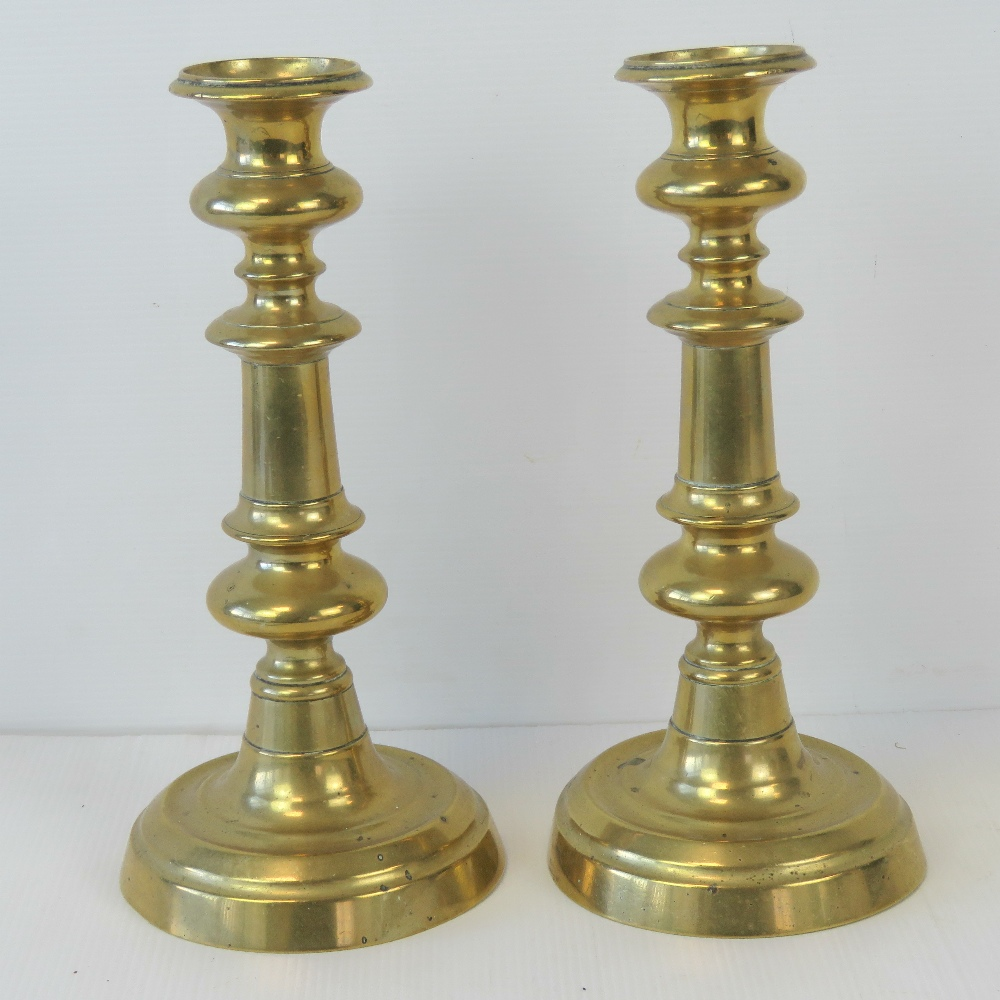 Lot 407 - A pair of Victorian heavy brass candlest