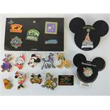 A quantity of Disney badges including; a