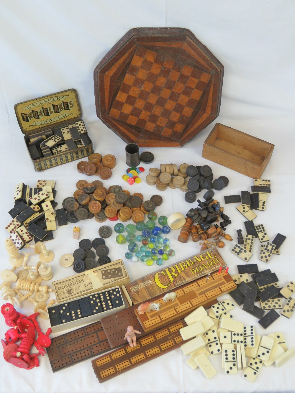 A large selection of vintage chess piece