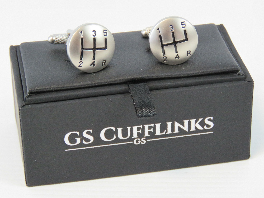 Lot 681 - A pair of as new gear stick cufflinks in