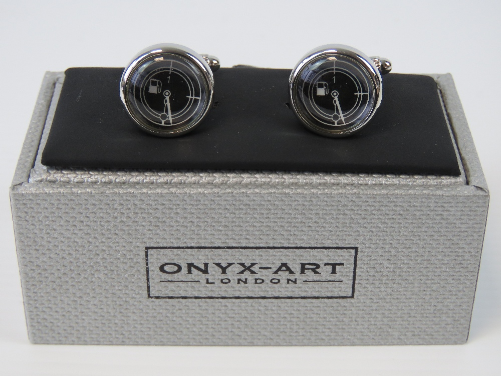 Lot 689 - A pair of as new fuel gauge cufflinks in