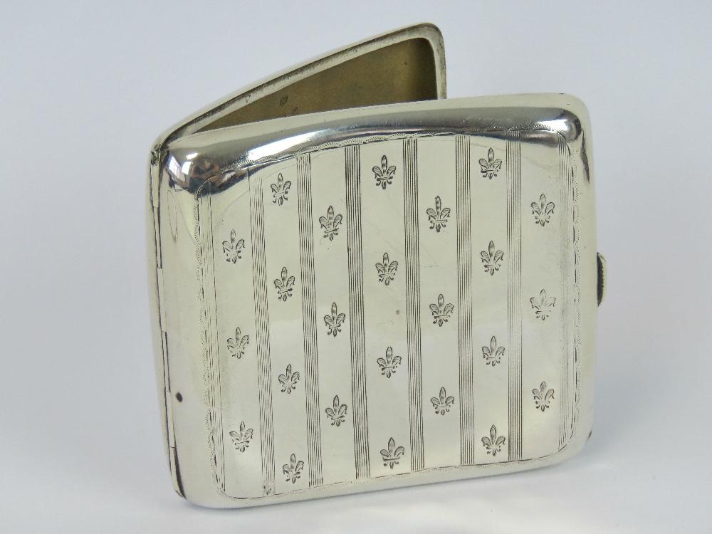 Lot 15 - A HM silver cigarette case having fleur-
