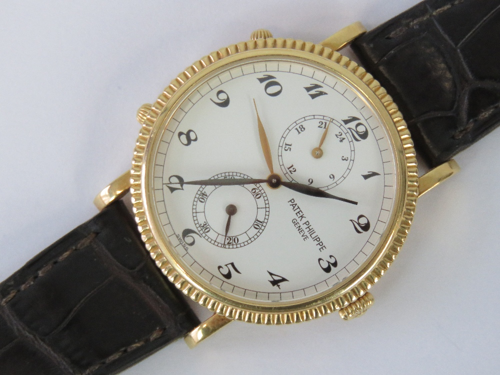 An 18ct gold Patek Philippe Travel Time