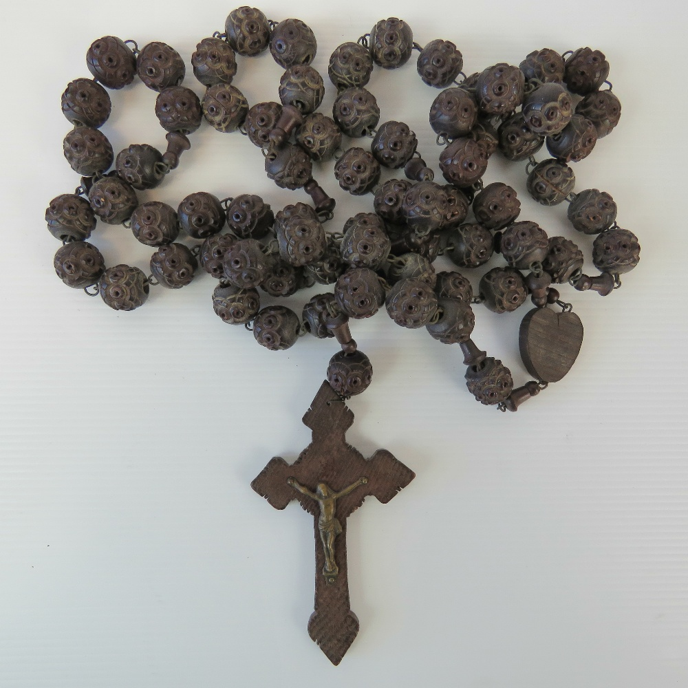 A large vintage carved set of rosary bea