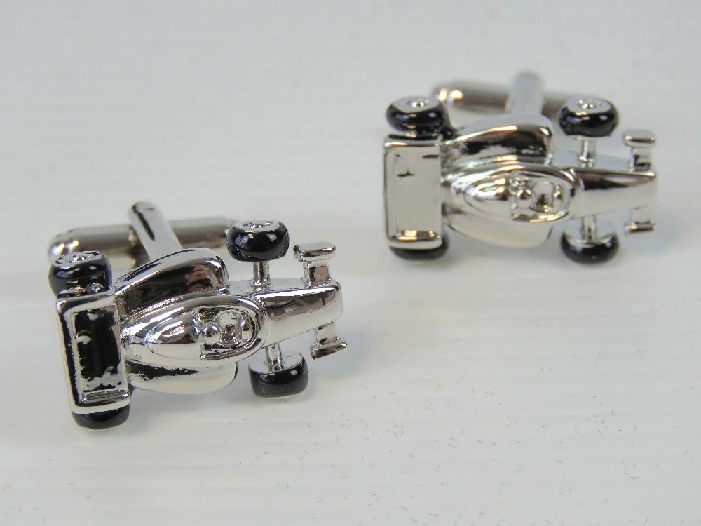 Lot 696 - A pair of as new F1 racecar cufflinks in