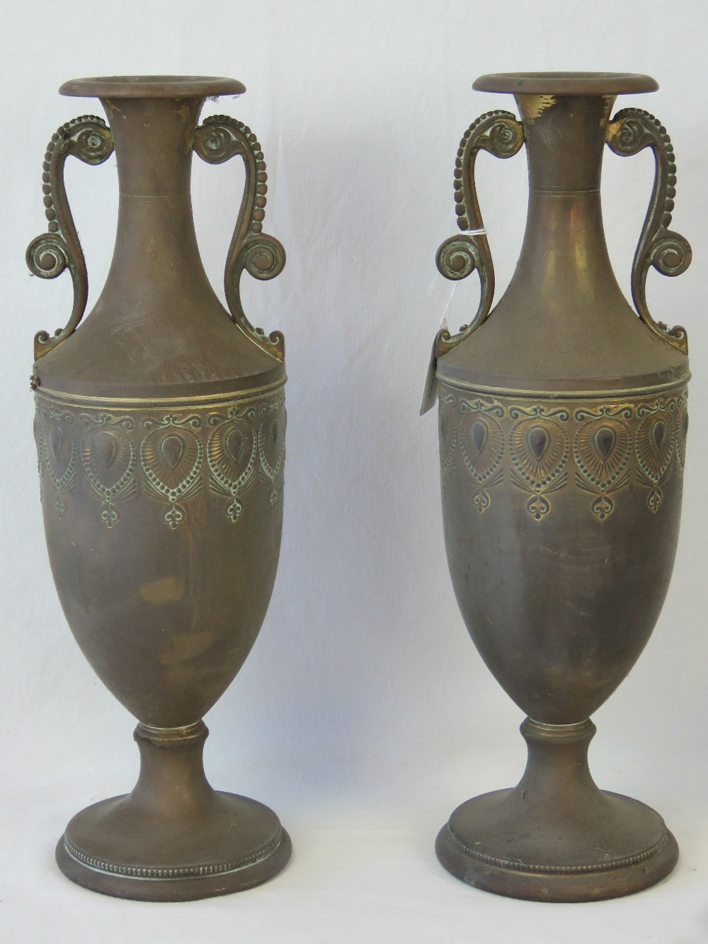 A pair of 20th century brass vases of Ro