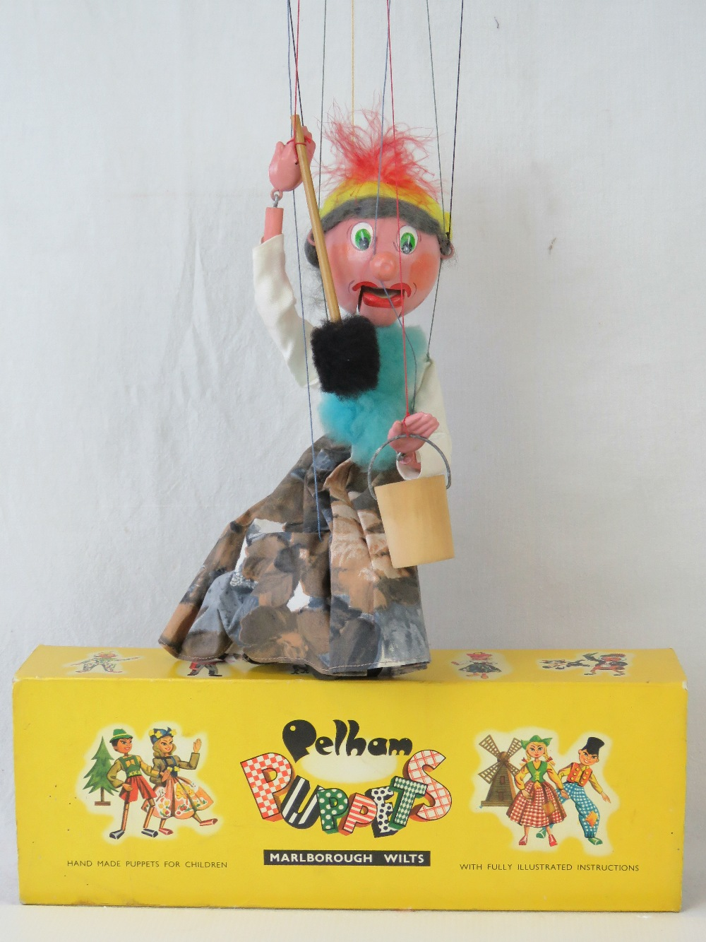 A Pelham puppet 'Old Lady' with bucket a
