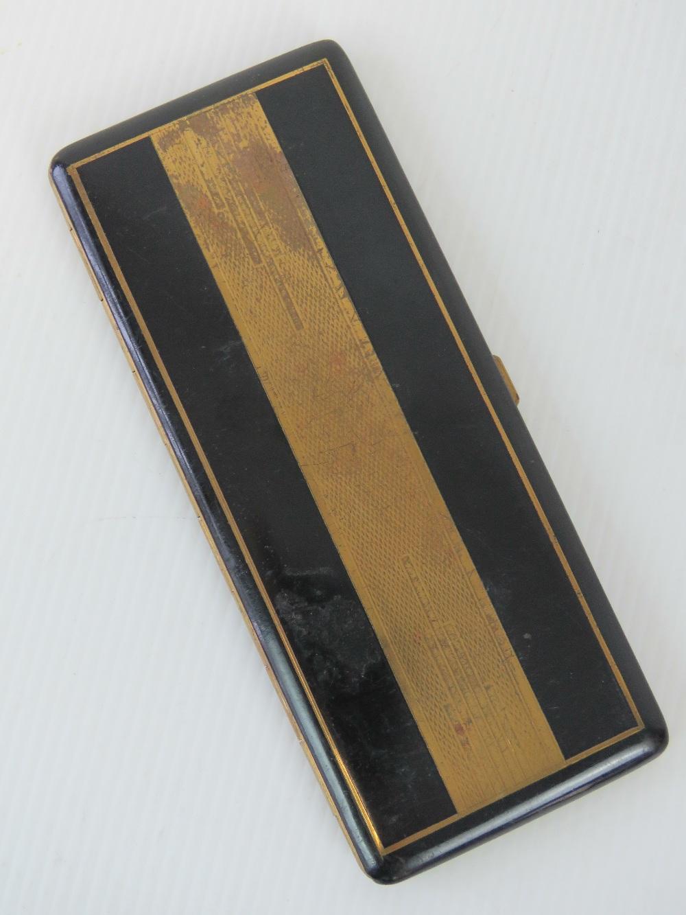 A French Art Deco black enamel cigarette