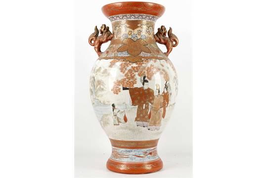 A Japanese Kutani Vase Late Meiji With Applied Buddhist Lion Dogs