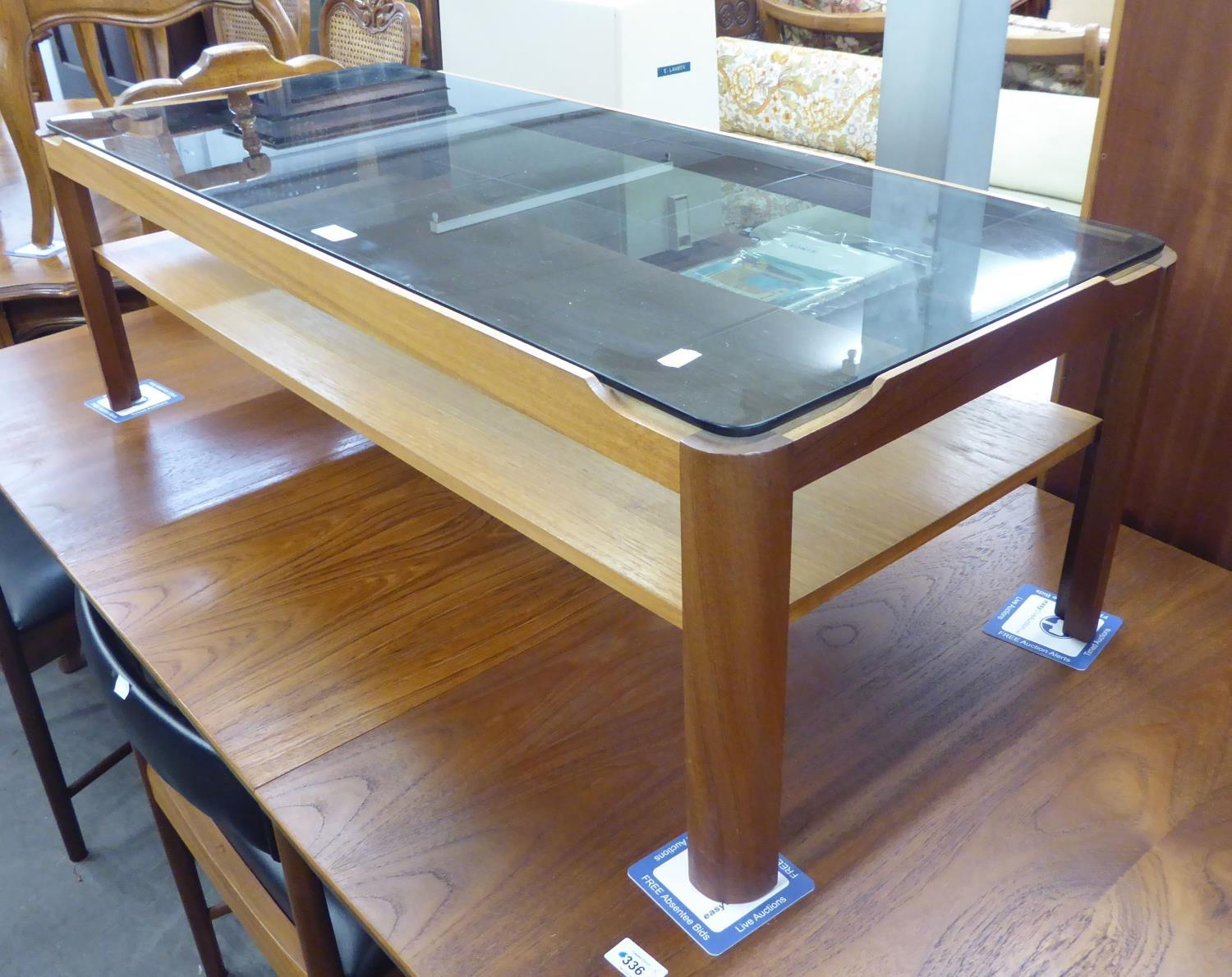 1960's/70's TEAK OBLONG COFFEE TABLE, WITH SMOKED GLASS TOP AND A MATCHING SQUARE COFFEE TABLE
