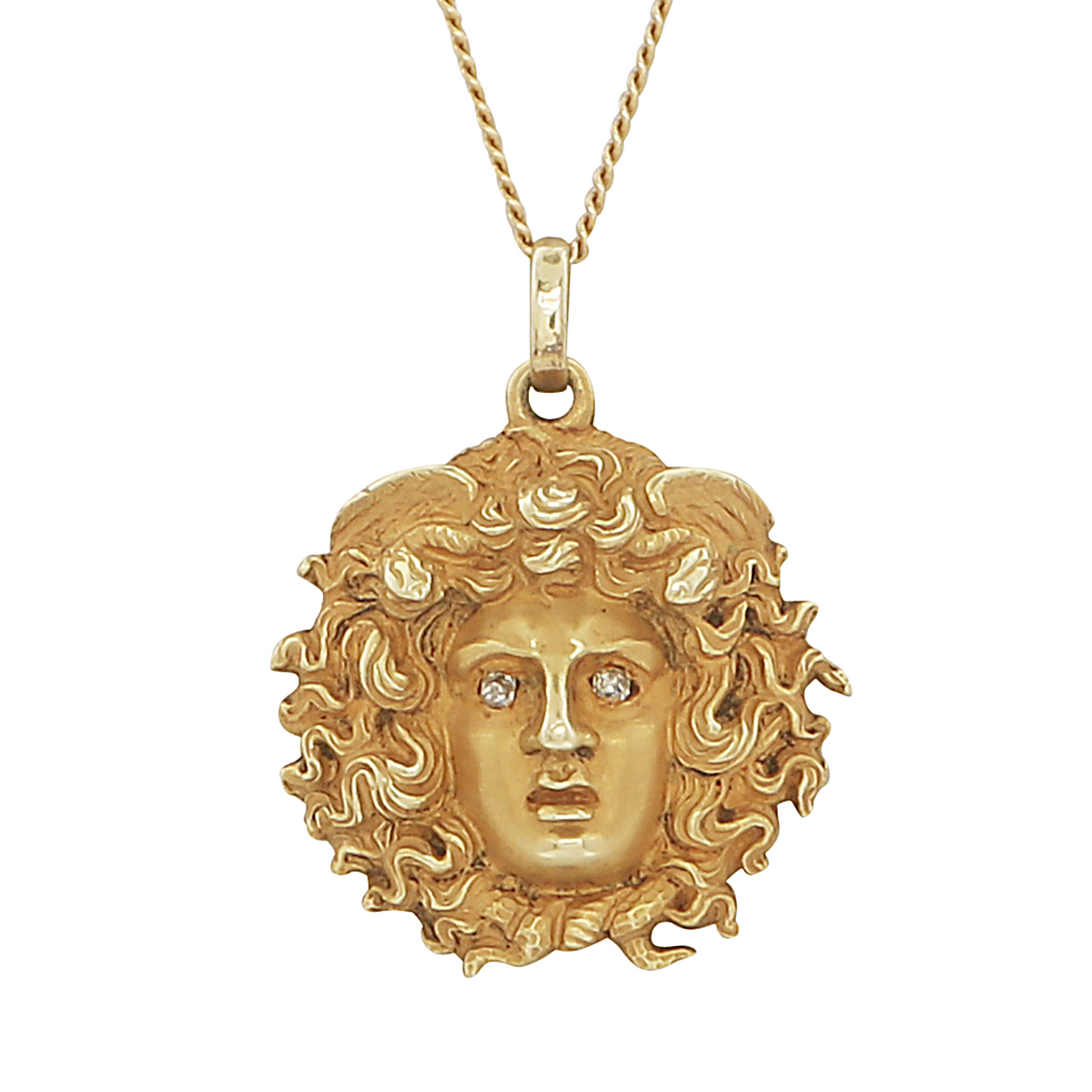 Los 219 - GREEK MYTHOLOGY - An antique jewelled pendant and chain in high carat yellow gold, modeled as the