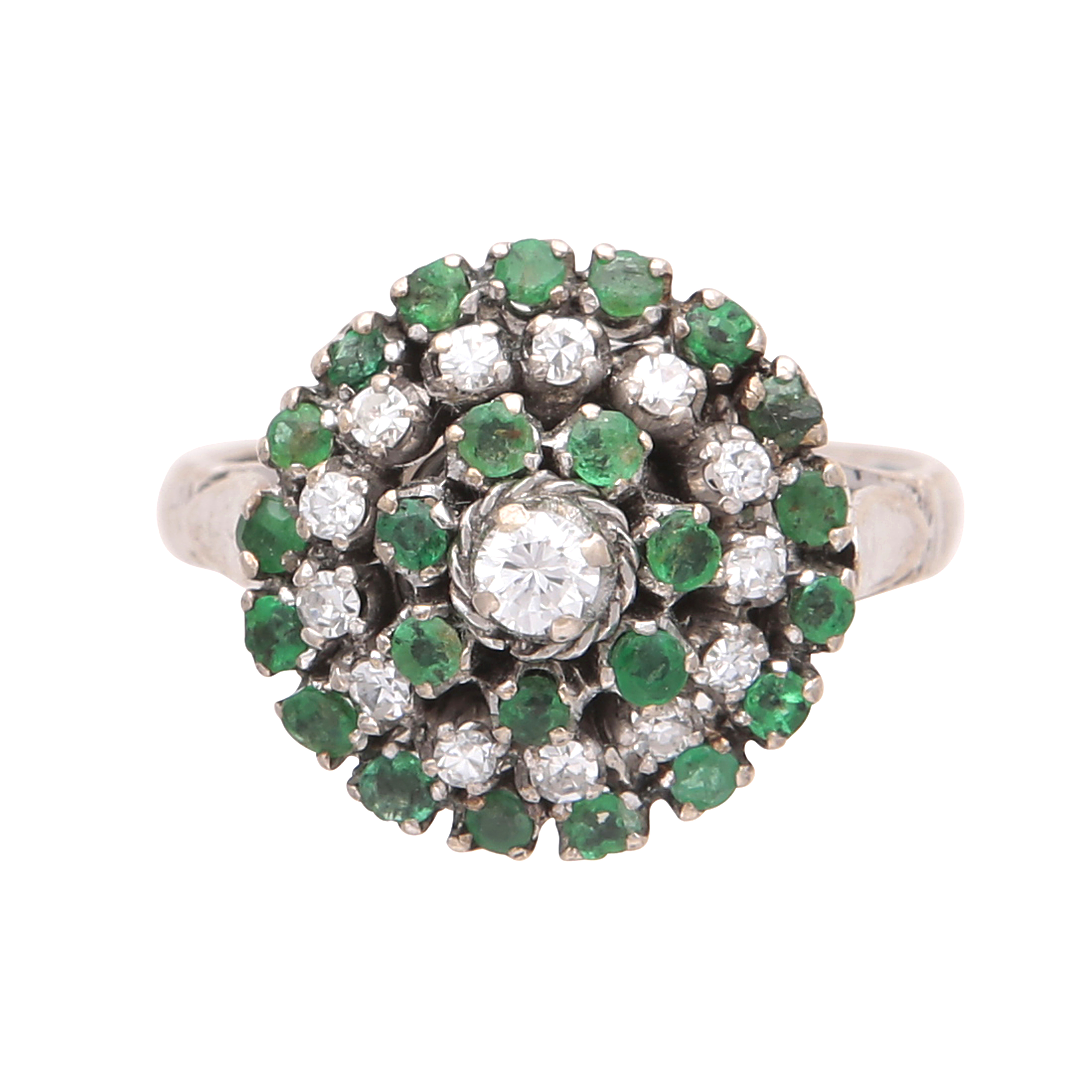 An emerald and diamond cluster ring in yellow gold, designed as a central round cut diamond