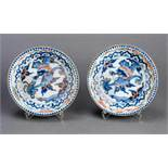 A PAIR OF MING-STYLE DRAGON BOWLS Porcelain. Japan, around 1900Both decorated in a soft underglaze