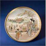 KINKOZAN: A SATSUMA PLATE WITH YOUNG LADIES Glazed ceramic with paint and gold. Japan, Meiji