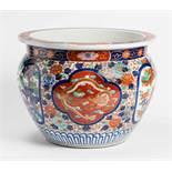 AN ELABORATELY ADORNED IMARI CACHEPOT Porcelain with enamel painting. Japan, Meiji period around