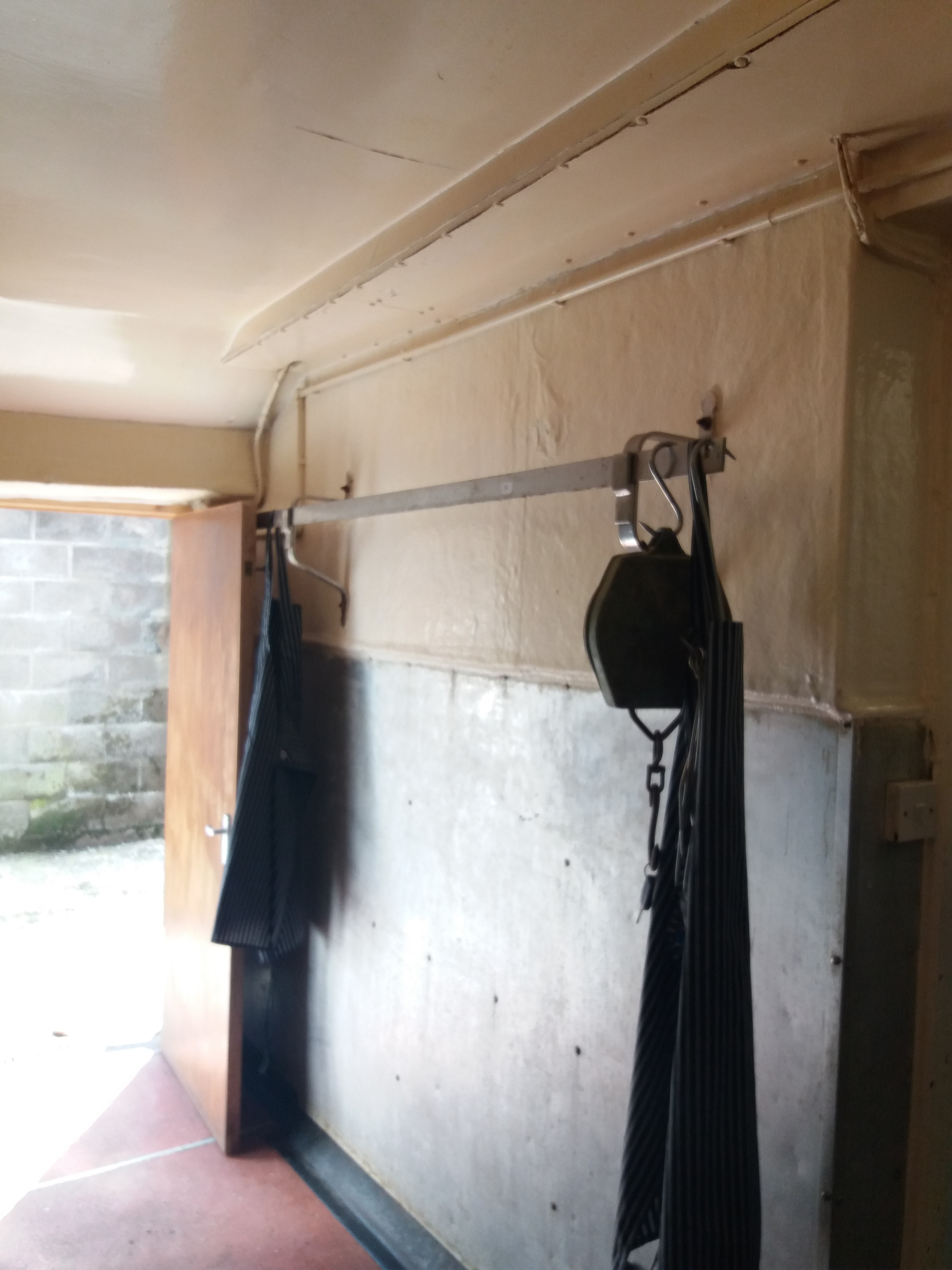 Lot 36 - Two straight metal meat hanging rails