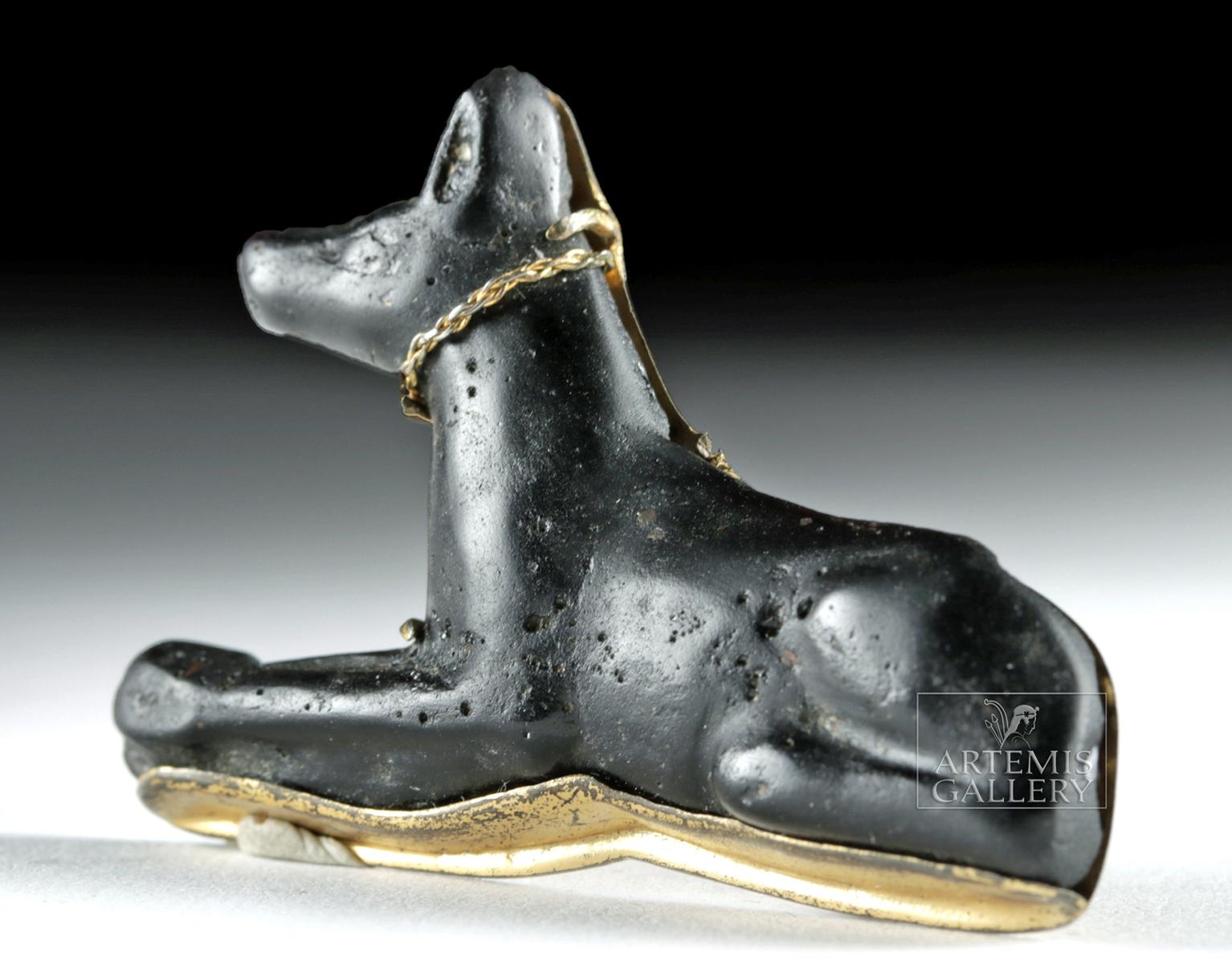 Lot 15 - Egyptian Black Glass Anubis w/ Gold Tone Setting