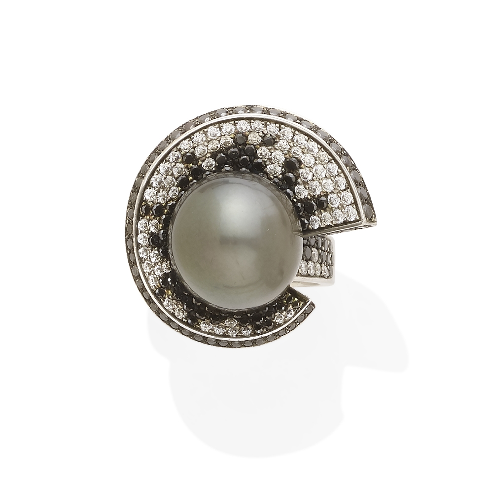A colored cultured pearl, colored diamond and diamond ring