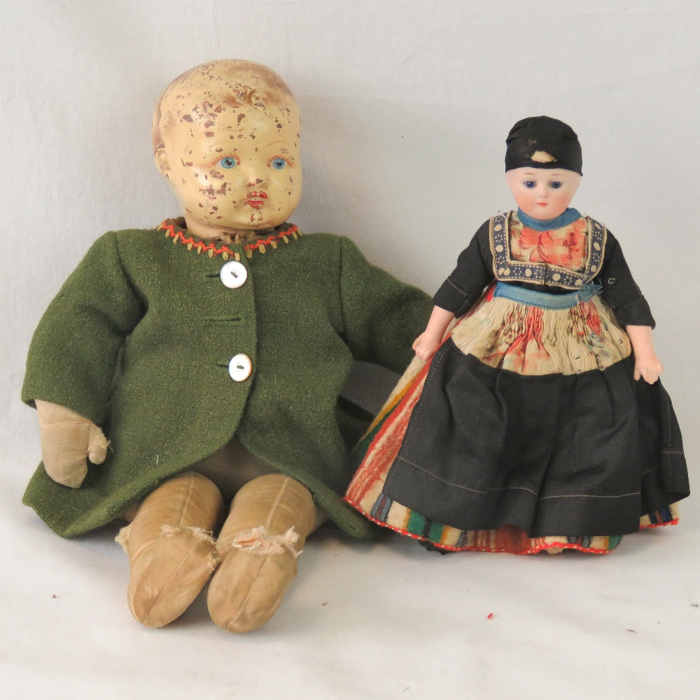 Lot 608 - A vintage doll having handpainted compos