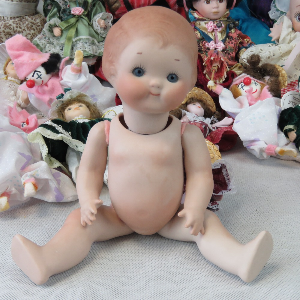 Lot 683 - A small Campbell Kid bisque baby doll si