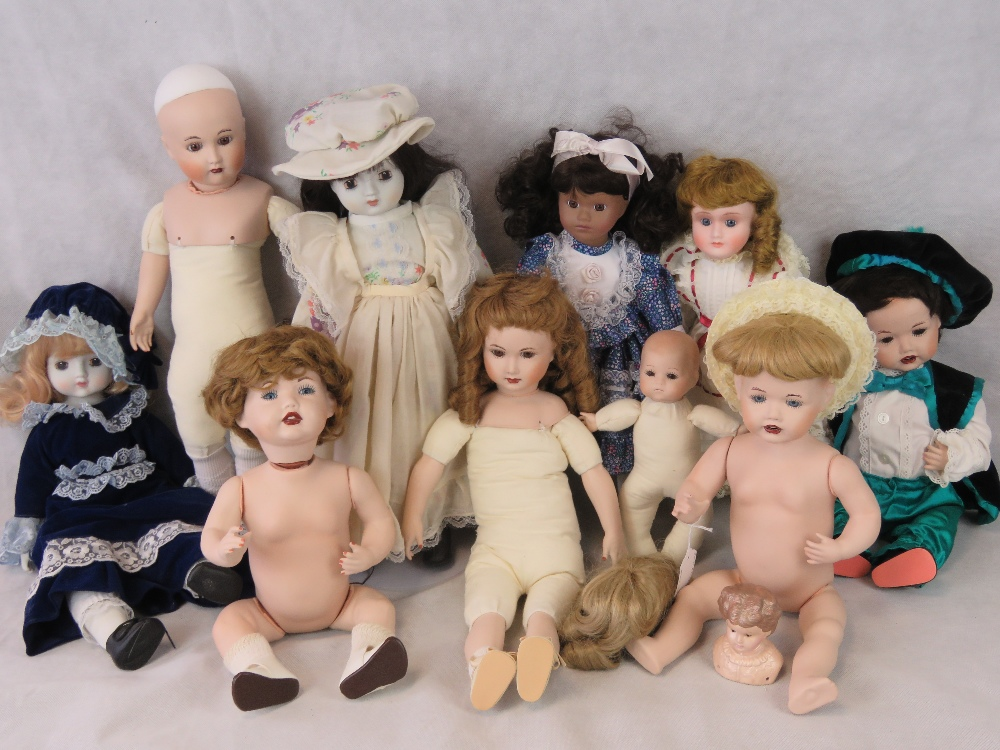 Lot 684 - Various modern bisque headed dolls, some