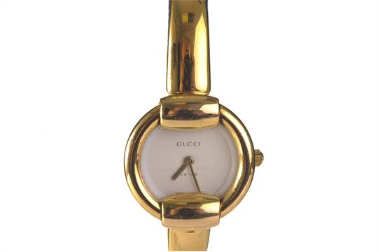 f793629bc72 A Gucci gold plated bracelet watch