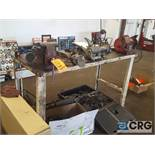 Lot includes a 5 foot metal work bench with a 6 inch double end grinder and 6 inch metal swivel