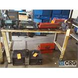 Lot includes 5 foot metal work bench with 6 inch double end grinder and 6 inch metal swivel bench