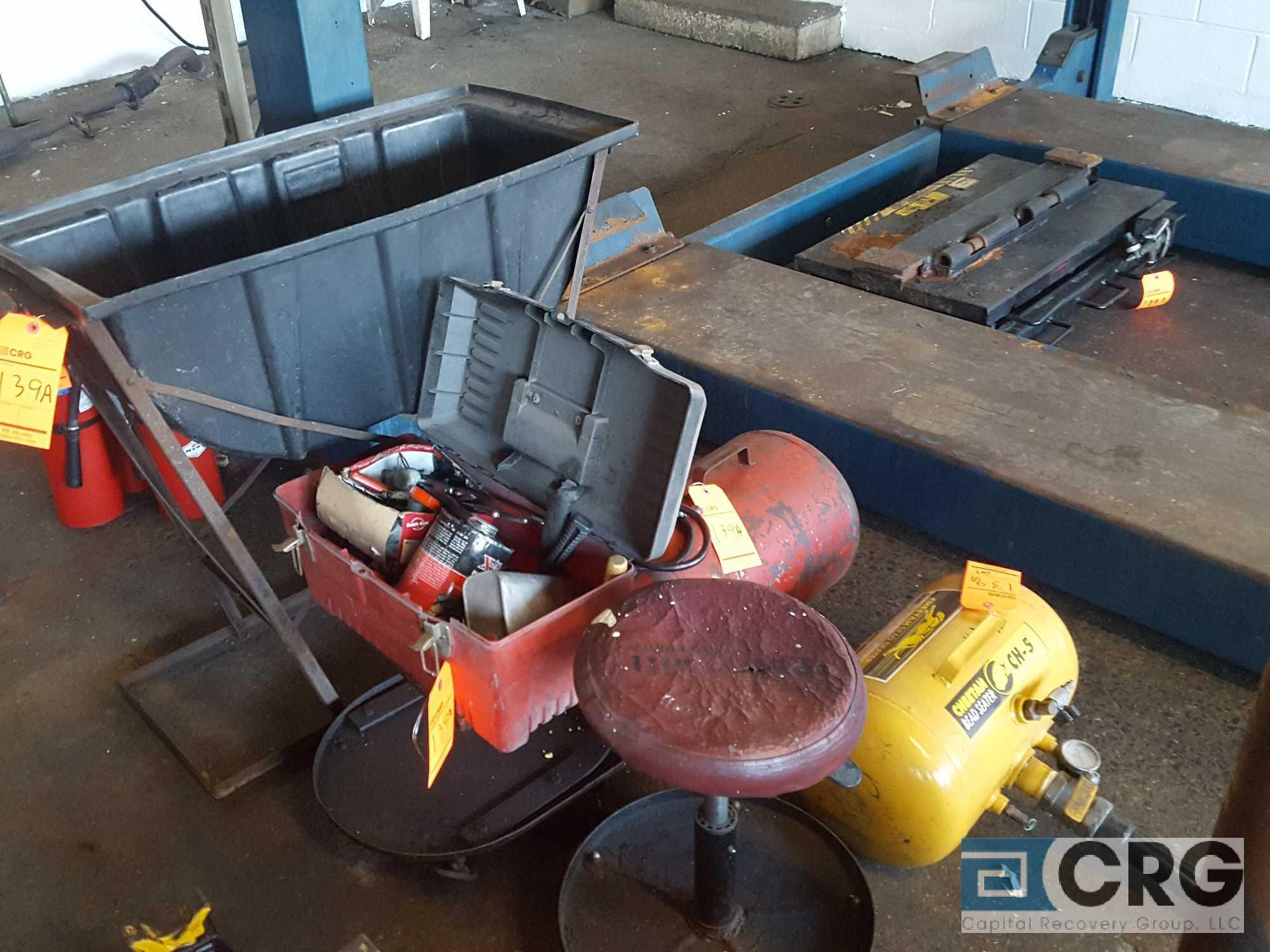 Lot of assorted tire repair devices, including (2) assorted air tanks, water tub leak detector, hand