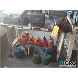 Lot includes a 4 foot metal work bench with 6 inch metal swivel bench vise . No other contents of