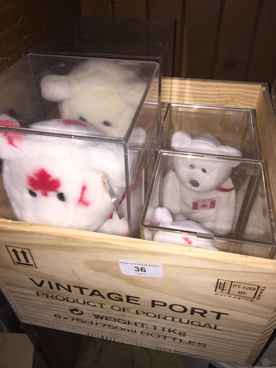 Lot 36 - A wooden box containing 4 boxed Canada Bears