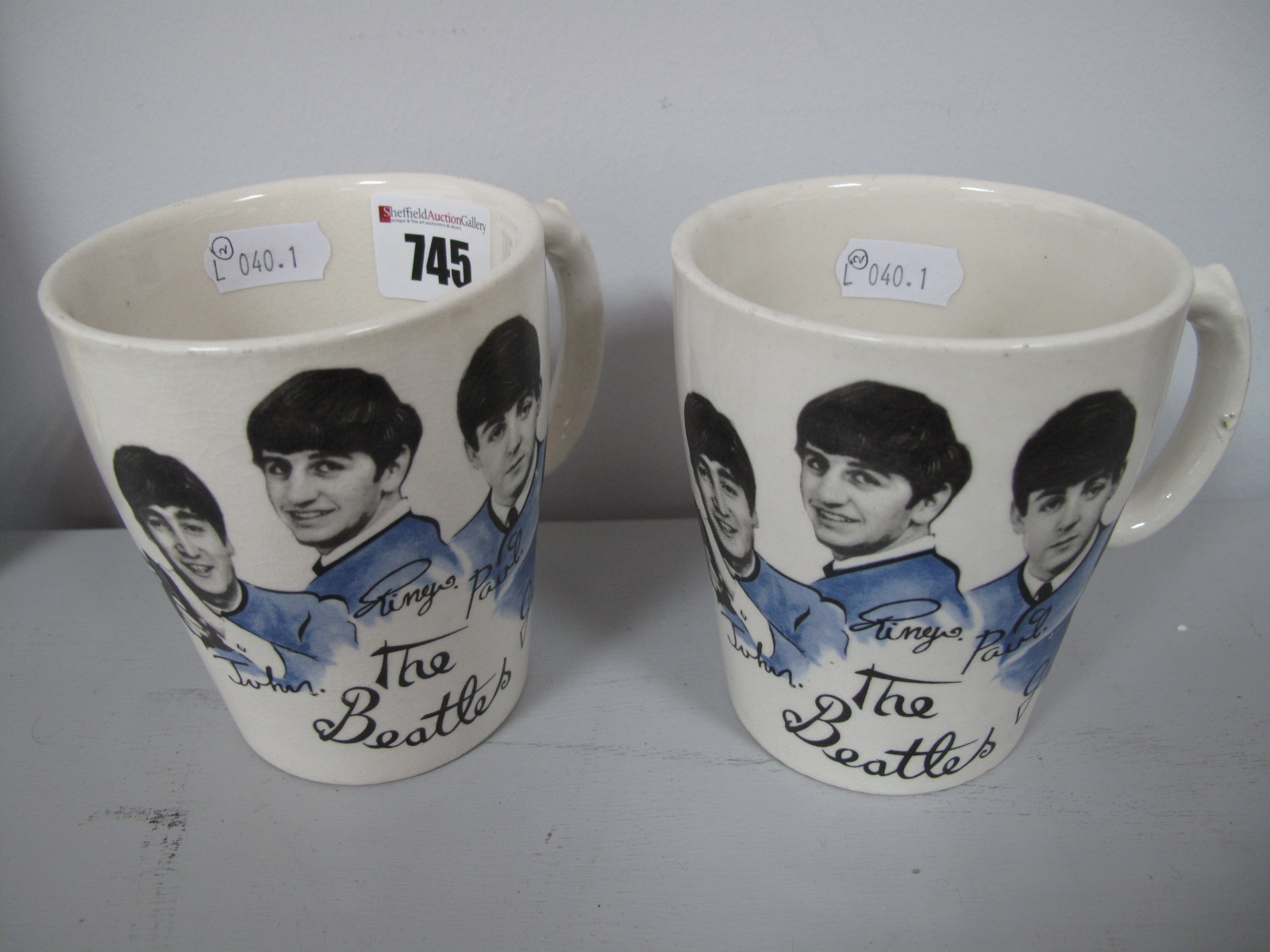 Lot 745 - Beatles Memorabilia- A Pair of 1960's Beatles Pottery Cups, printed 'The Beatles' with each band