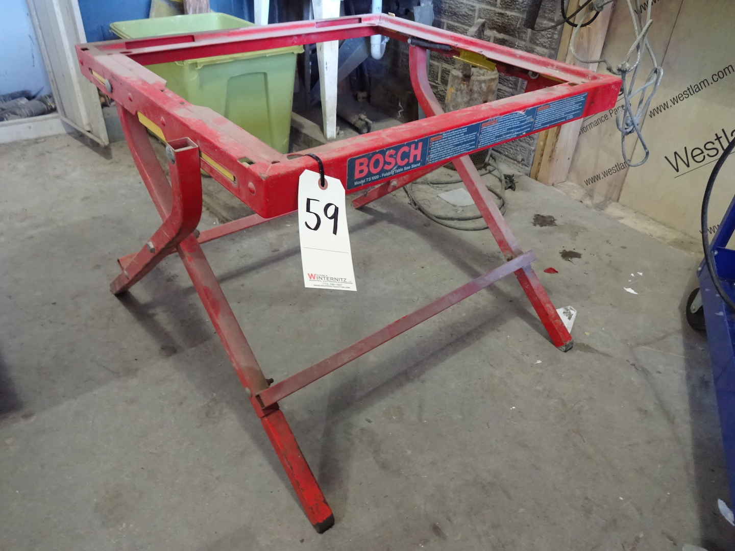 Lot 59 - BOSCH MODEL TS1000 FOLDING TABLE SAW STAND