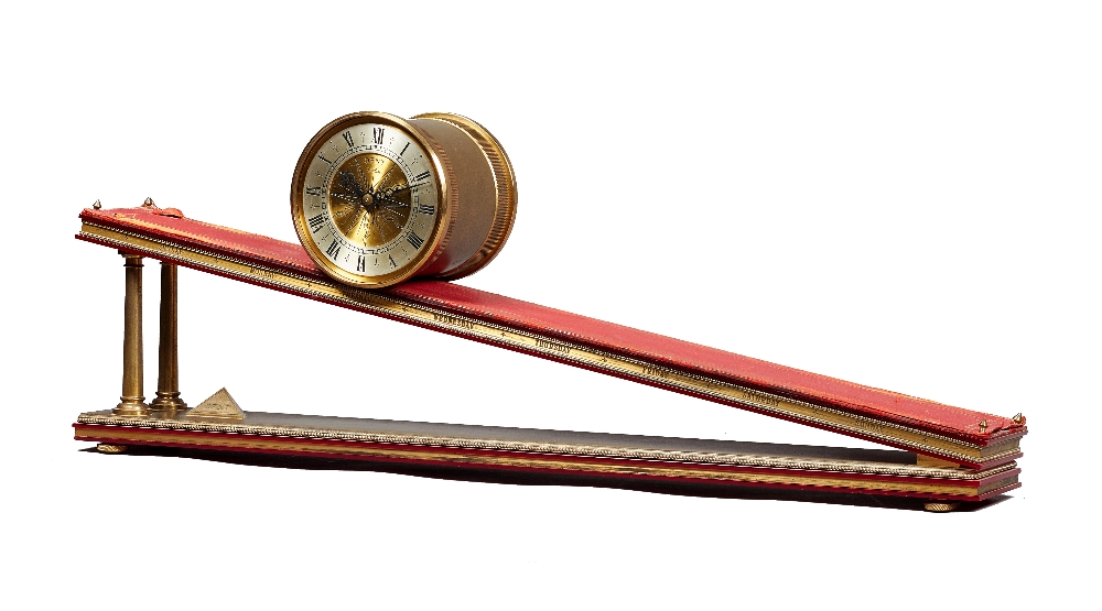 Lot 772 - A brass, red perspex and leather-lined inclined plane timepiece Dent, London, by Andrew Fell,