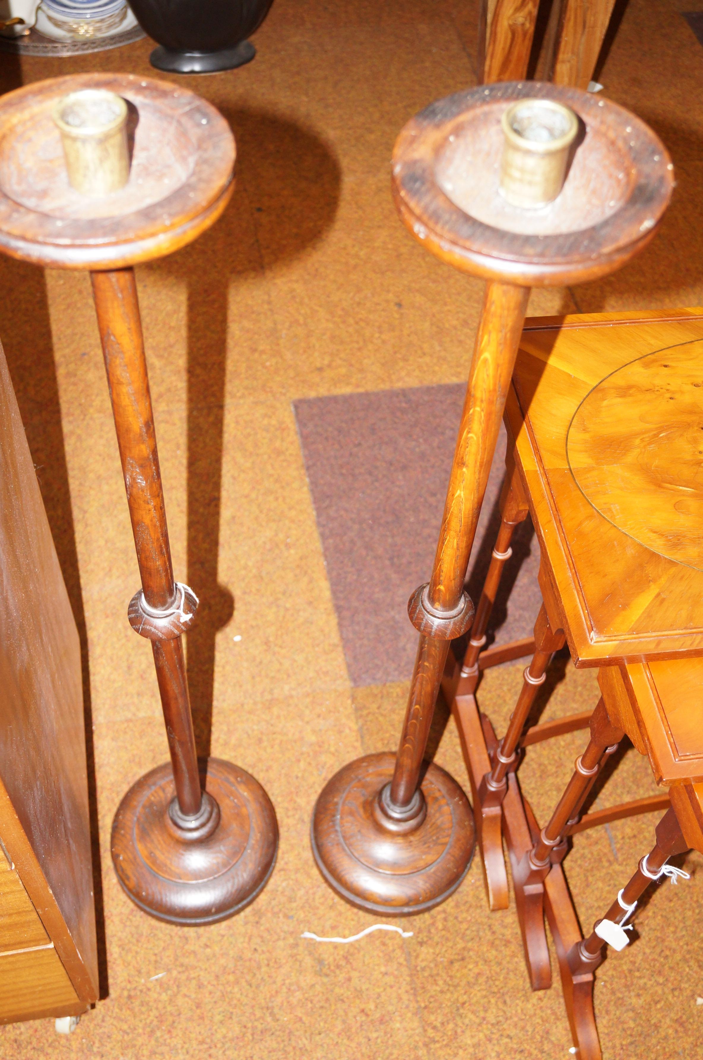 Lot 214 - Pair of oak free standing candle sticks