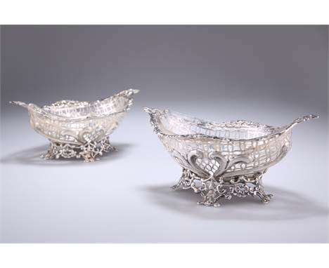 A PAIR OF VICTORIAN SILVER DISHES,byWilliam Comyns & Sons, London 1892, shaped oval, pierced and embossed wit