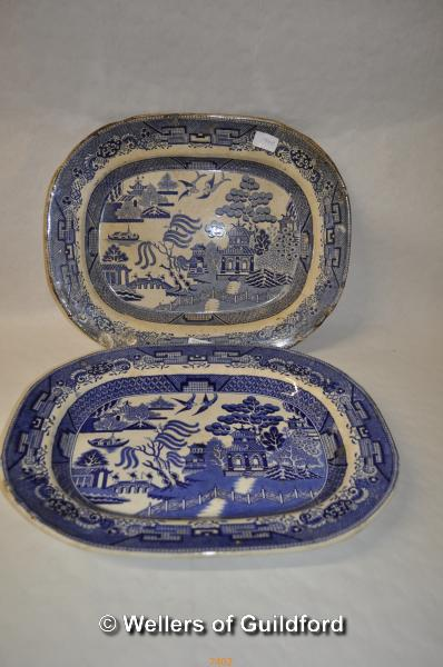 Lot 7402 - A near pair of Willow pattern blue and white meat plates.