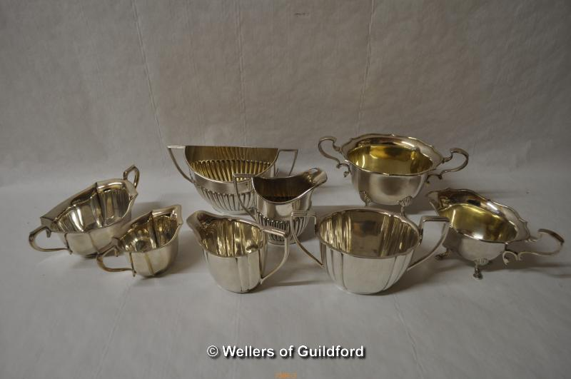 Lot 7306 - A group of silver plated three piece tea services and part tea services.
